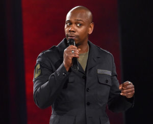 Netflix Defends Dave Chappelle Doc & Suspends Protesting Staffers